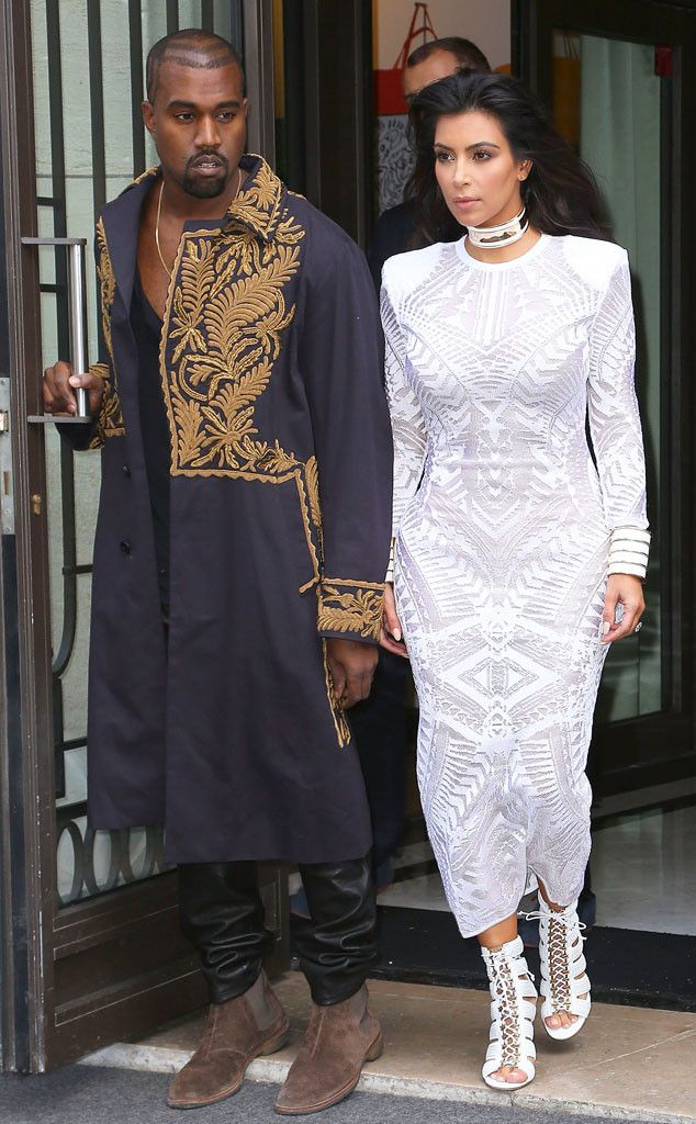 Kanye West and Kim Kardashian are fashion royalty at the Balmain show at Paris Fashion Week.
