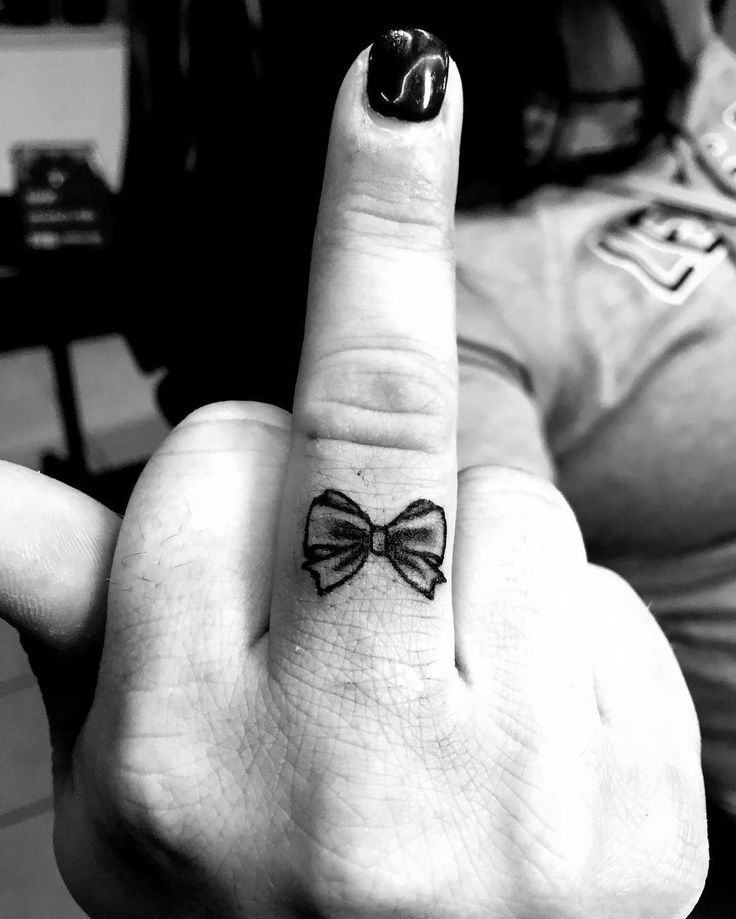 Flip the bird in style with this Dainty little middle finger Bow  tattoo by…