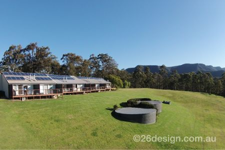 Our elevated position gives villas a beautiful view of the Hunter Valley. Kangaroos regularly munch on our beautiful green grass early in the mornings. Image courtesy of 26design.com.au