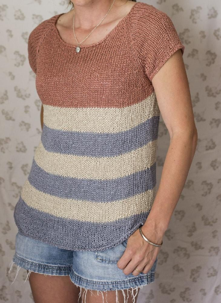 A lightweight, breezy, tee worked up in the most comfortable, chic, linen. This seamless shirt is knit from the top down with short rows incorporated to help achieve comfort as well as to gently shape the split hem.Straightforward and quick; knit it under the umbrella at the beach today and wear it sailing tomorrow.Sample is shown in Quince and Co. Kestrel. A substitute yarn is shown below.