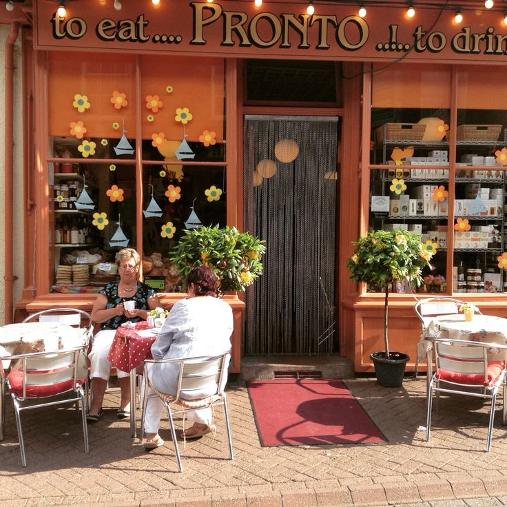 A couple of lovely customers enjoying a cappuccino in the sun at Pronto Deli Leek