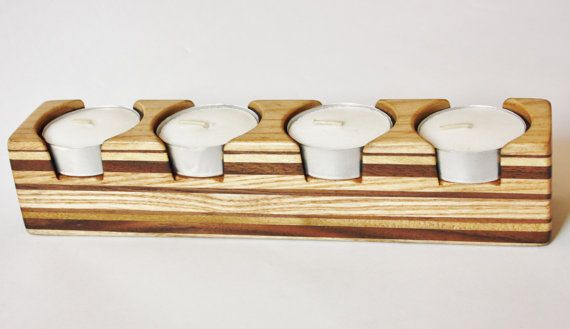 Ich mache die Tee-Licht-Inhabern von hand aus aufgearbeiteten hart- und Holz, das mit ein paar Schichten des dänischen Öl zu bringen, das Korn und natürliche Schönheit der verwendeten Hölzer beendet ist. Jede kleinen Unvollkommenheiten sind aufgrund der früheren Leben des Holzes und das Stück Zeichen hinzufügen. Ca. Maße:- Länge: 200mm (7,87) Breite: 35mm (1,38) Höhe: 40mm (1,57)