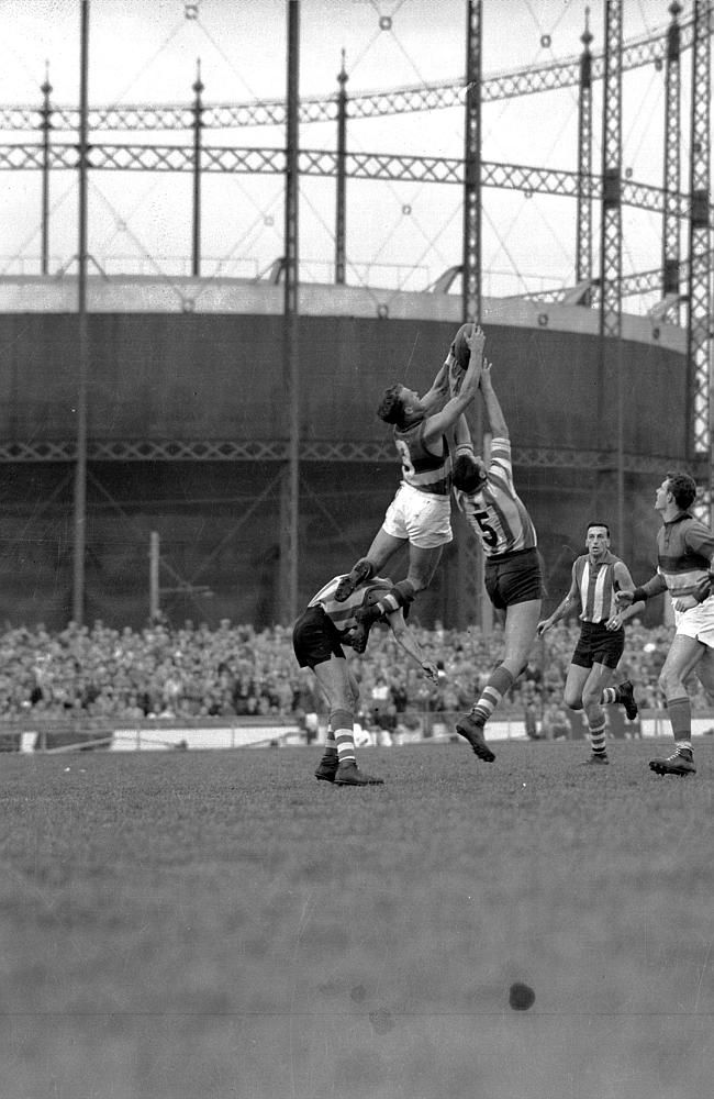 Victoria, Australia 1960s: April 1960: Footscray footballer Ted Whitten taking a mark against North Melbourne at the ...