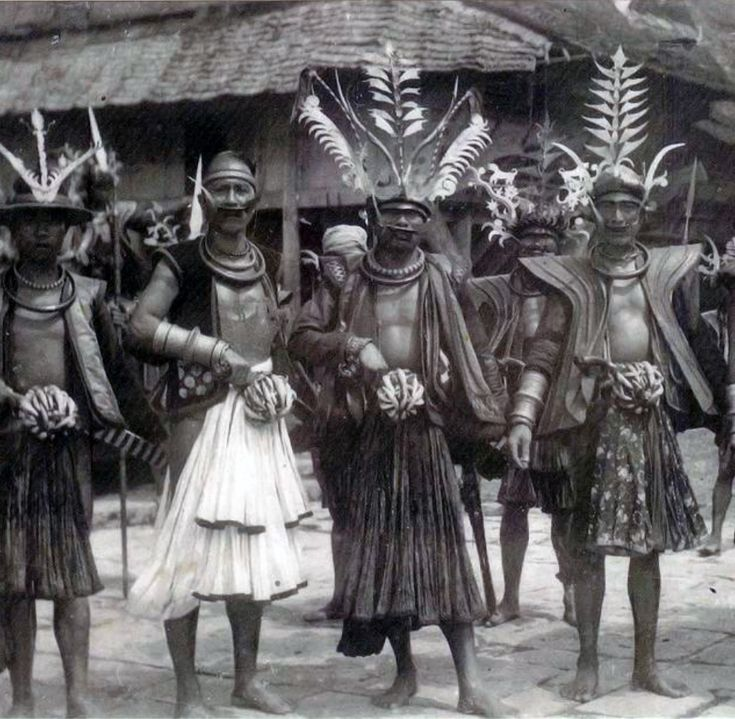 Indonesia | Warriors on Nias Island. ca. 1920 | Postcard; photographer Leo Haas