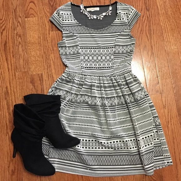 Black & White Aztec Print Fit n Flare Dress Great cap sleeve fit n flare dress. Aztec pattern works well with bright, bold accessories. This is also a great fall and winter dress because it looks perfect with black tights and boots or booties. 98% polyester/2% spandex. Good used condition. Dresses Mini
