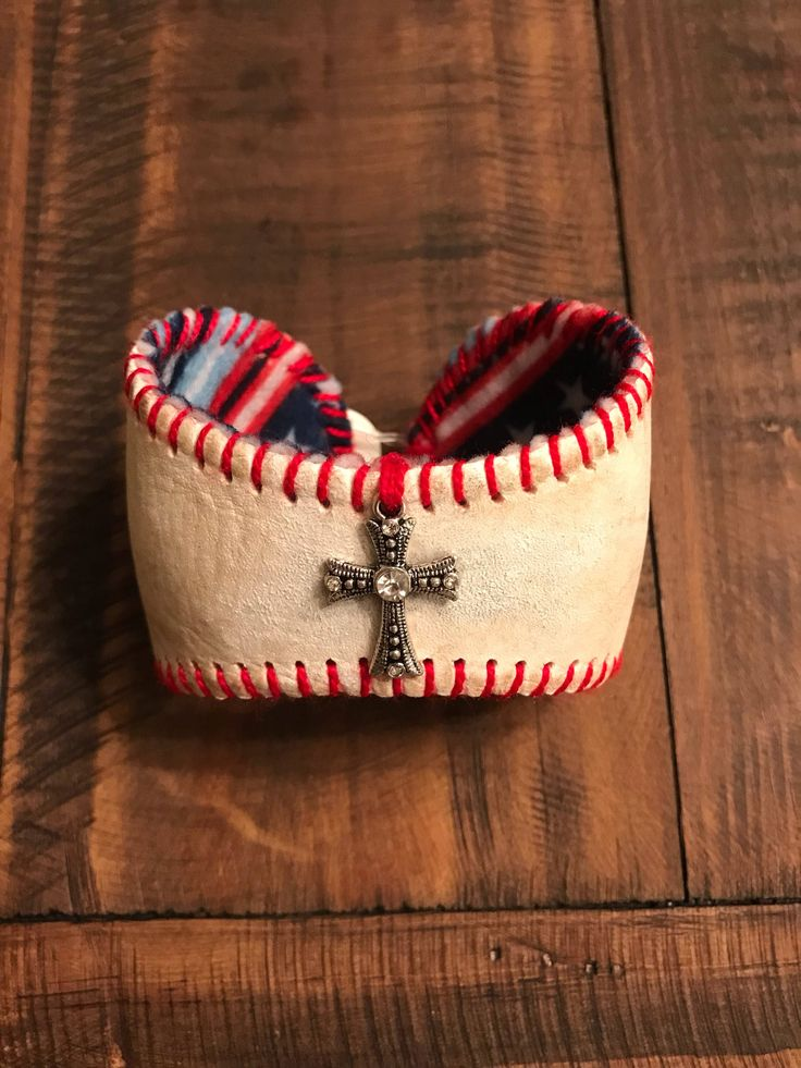 A personal favorite from my Etsy shop https://www.etsy.com/listing/575863212/baseball-bracelet-cuff-with-a-cross