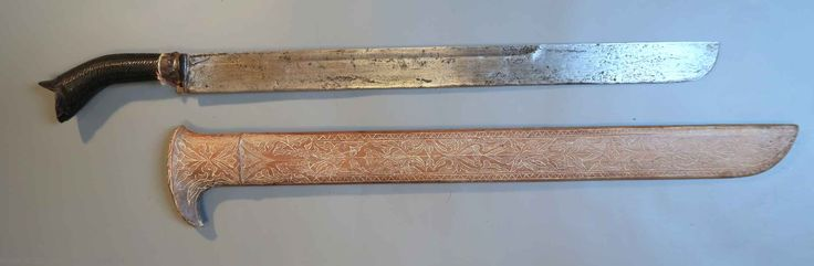 Klewang from Atjeh. extra long blade with  hilt decorated with traditional motifs. A sword like this may have been used in the Atjeh wars against the Dutch in 1873-1914.