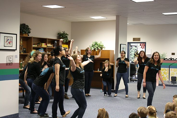 The Whim 'n Rhythm singers perform in the Intermediate School commons