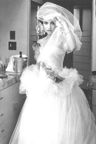 madonna on her wedding day (to sean penn) ....there is no excuse for that dress...actually there is: the eighties...