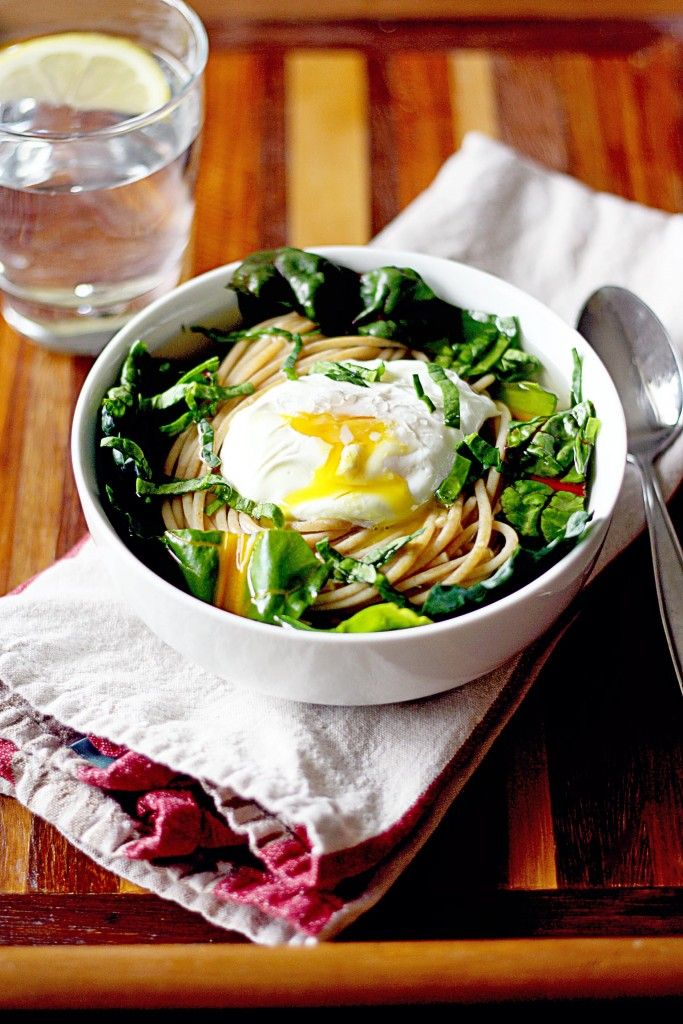 A bowl of swiss chard, noodles, broth and poached egg makes a wholesome and easy meal.