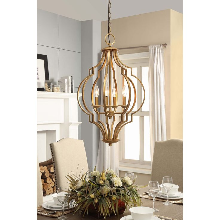 Resemblant of a fine open and airy bird cage, this gold leaf chandelier is filled with luminous candelabra bulbs to create a stunning look in your dining room or entryway. The Trellis four-light fixture will ad an air of refinement to your home.