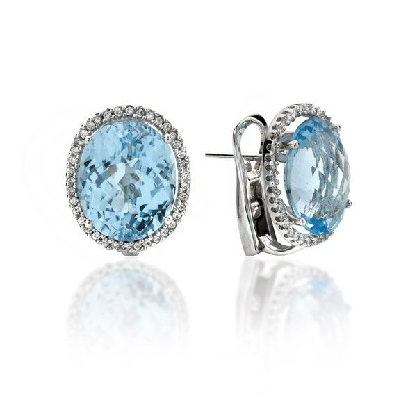 A stunning pair of oval blue topaz and diamond cluster earrings, mounted in a fine 18ct white gold setting.