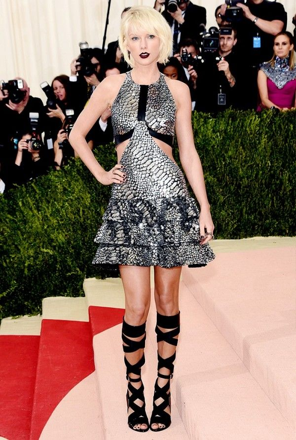 Taylor Swift was joined in on the silver trend at the Met Gala in NYC in a Louis Vuitton cut-out dress and strapy heels