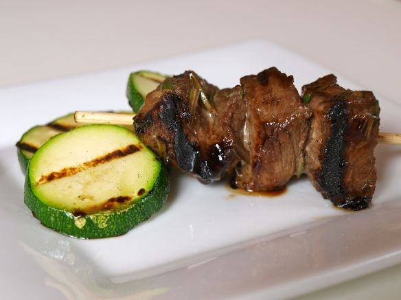 Balsamic vinegar, Soy sauce, fresh rosemary, garlic, salt and pepper...great steak kebab marinade.