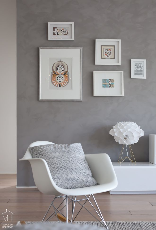 Beautiful gray wall with graphics standing out. Via Valkoinen Harmaja.  - a wall idea for the hallway.