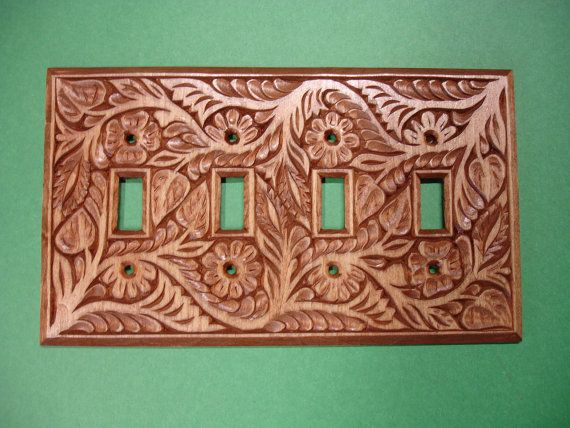 Quadruple electric switch cover plate, hand carved of solid wood