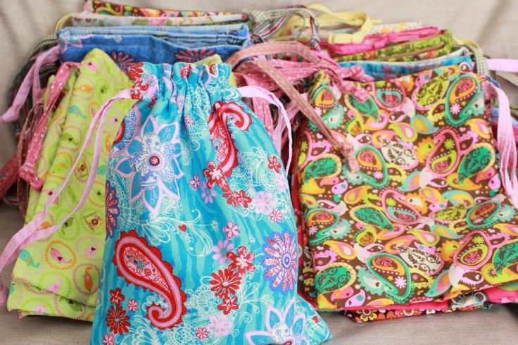 A great, simple sewing project - this could be something useful for teaching both boys and girls simple sewing techniques-a drawstring pouch.