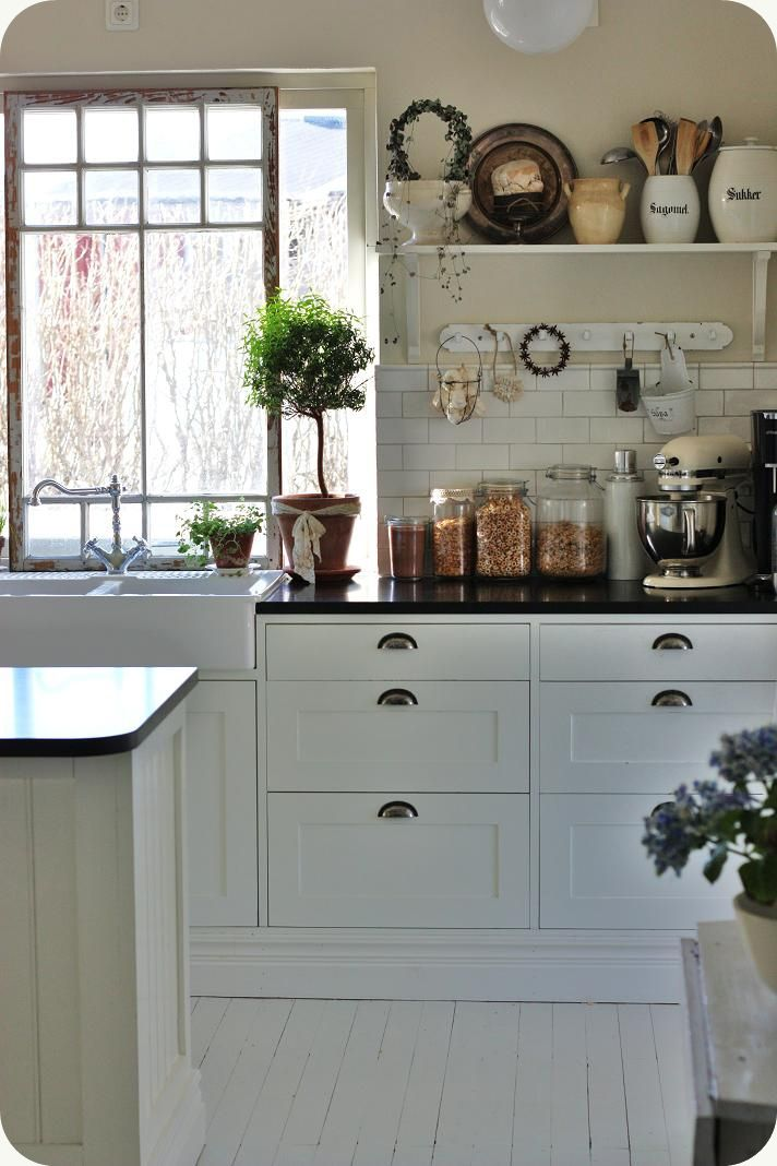 Love the cabinets, pulls, farmhouse sink and wall color!