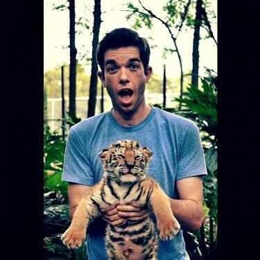 John Mulaney with a baby tiger.