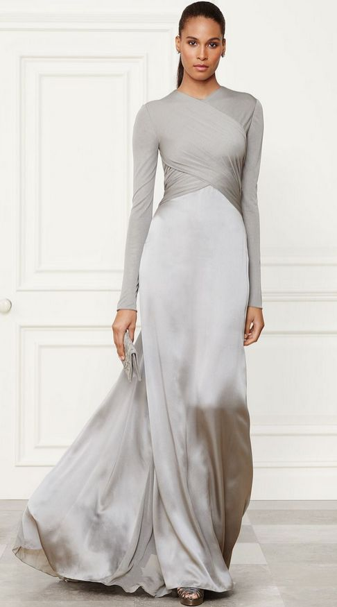 "Dazzle others in this stunning metallic ensemble perfect for any formal event. Complete the ""look"" of this long sleeve silk gown w/ a small silver clutch & a fab pair of heels."