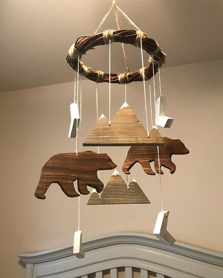 """Custom woodland nursery themed baby mobile with bears, mountains, and chevron arrows and a branch top. Colors are brown, gray, white. Material is wood. Hand cut and painted by Sea Bee Market. Follow link for custom order placements! Gender neutral, little boys or little girls nursery mobile. Unique and handmade! 47 Likes, 5 Comments - Sea Bee Market (@seabeemarket) on Instagram: """"Finally finished up this custom ordered mobile! This would work for a little boy's or a gender…"""""""