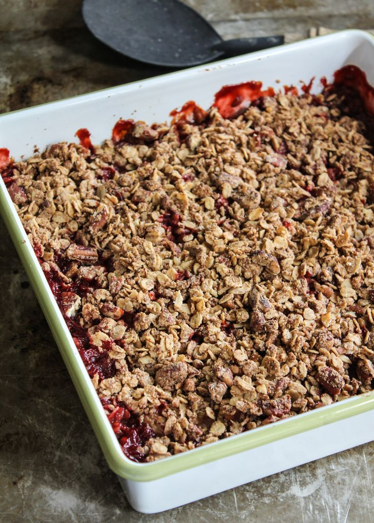 A lightened up version of everyone's favorite strawberry rhubarb crisp with a delicious oat-pecan topping and a touch of vanilla. Gluten free, vegan, and refined sugar free!