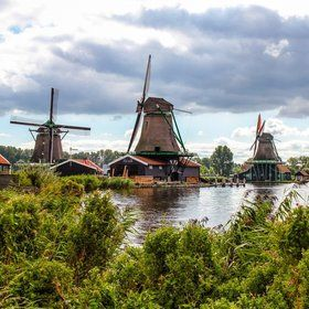 Zaanse Schans The Netherlands. Outdoor museum of traditional Dutch foods and goods. We watched them make cheese, paper from the windmills, wooden shoes and pewter. So much fun!