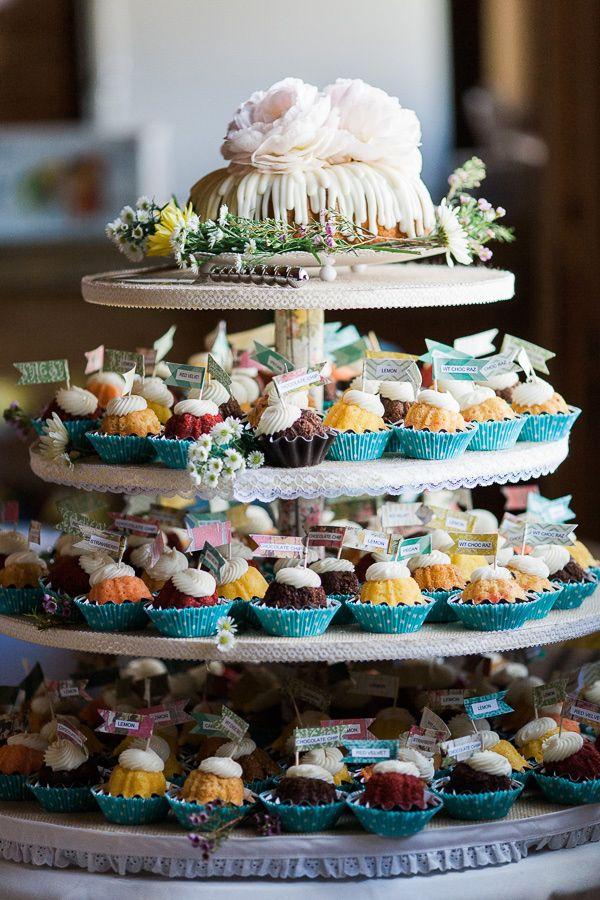 mini bundt cake tower, photo by Rachel Havel http://ruffledblog.com/woodland-park-wedding #weddingideas #desserts #bundtcake