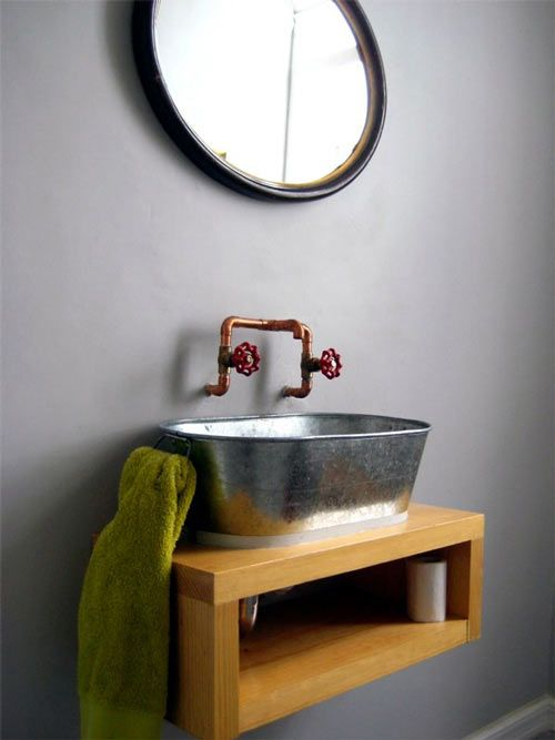 Love the floating shelf and wash basin sink.  I would pair it with a simple and modern chrome faucet though...