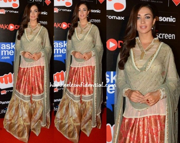 Amy Jackson in Kotwara by Meera & Muzaffar Ali. Orange Brocade Garara set