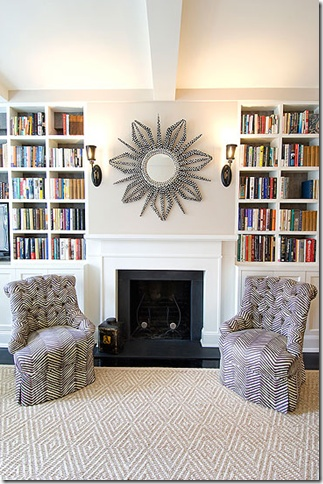 Built-in bookshelves around the fireplace. i like the colors and lighting