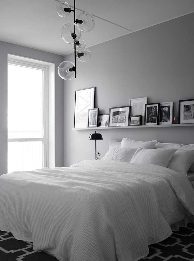 A grey wall with white furniture and bedding creates a calm and serene feel to any bedroom. Get ready to unwind and drift off to sleep!