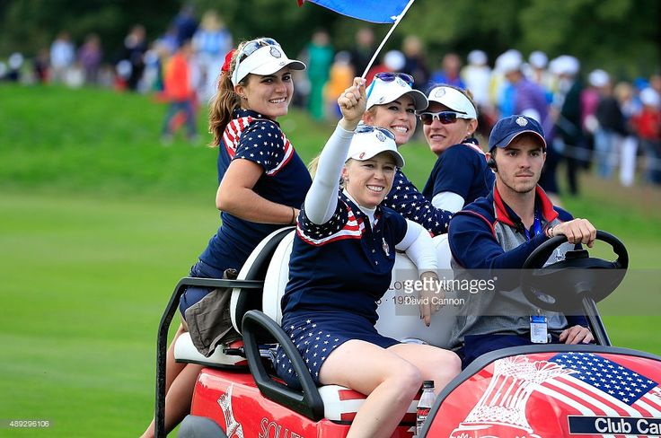 Lexi Thompson, Morgan Pressel, Paula Creamer and Brittany Lang celebrate on a team buggy after the match was decided during the final day singles matches in the 2015 Solheim Cup at St Leon-Rot Golf Club on September 20, 2015 in Sankt Leon-Rot, Germany.