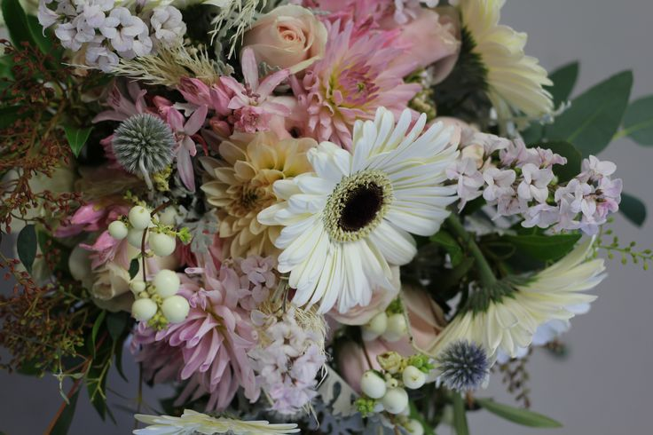 black eyed gerberas in vintage bouquet http://www.wanakaweddingflowers.co.nz/gallery/