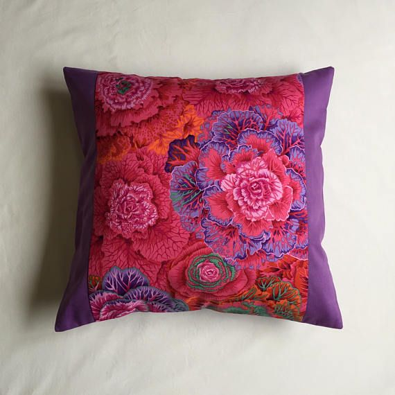 Beautiful Kaffe Fassett designed fabric, make this cushion very special. It would make a lovely statement in your living room or bedroom. A perfect gift for birthdays, anniversaries, new home or just because you want to refresh your decor. Each cushion measures 18 by 18 (46cms by 46cms) The cushion covers are double lined in the front and the seams are fully finished for extra durability. They have a plain lilac back and zip closure. They can be bought with or without the polyester filled...