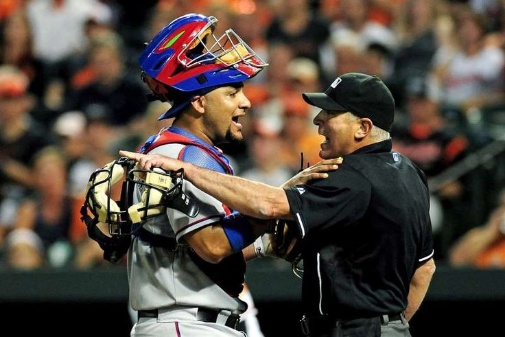 Everything is under control -        Texas Rangers catcher Carlos Corporan talks with home plate umpire John Hirschbeck during a game against the Baltimore Orioles on June 29 in Baltimore.   -  © Evan Habeeb/USA TODAY Sports