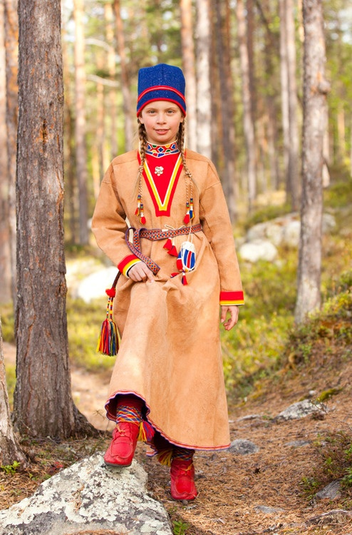 Europe | Portrait of a Saami girl wearing traditional clothes, Jokkmokk, Swedish Lapland, Sweden | © Laila Duran #tassel #braids