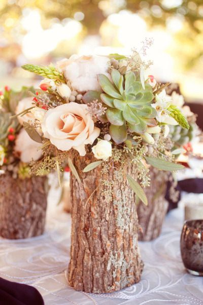 Natural wood vases, peach flowers, coral berries and succulents make a beautiful rustic centerpiece.