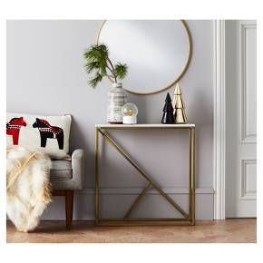 Brighten up your space with the Round Decorative Wall Mirror from Project 62™. This mirror brings modern style with its thin metal frame and gleaming brass finish. It complements a variety of furniture shapes and styles. Hang this wall mirror over a bathroom sink or in the entryway to add light, depth and dimension.<br><br>1962 was a big year. Modernist design hit its peak and moved into homes across the country. And in Minnesota, Target was born — with the revo...
