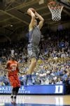 Duke's Mason Plumlee (5) dunks past Maryland's James Padgett (35)