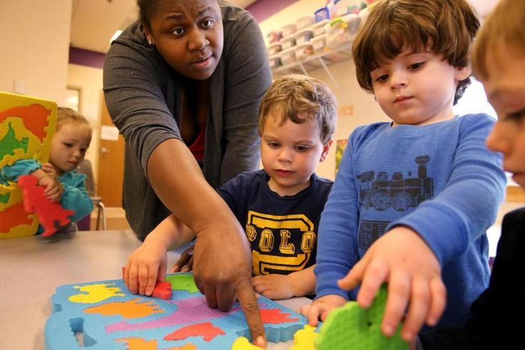 Worcester, MA- April 25, 2017: Teacher Latonya Hazard work on puzzles with students (left to right) Lilyana Waire (cq) , 2, Jordan Conrad (cq) 2, Caiden Groccia (cq), 2, and Joshua Davis (cq) 2, at the Guild of St. Agnes in Worcester, MA on April 25, 2017. The Guild of St. Agnes is an early education and care agency that relies on state subsidies for 95% of their students according to director Gloria Johnson. The availability of state-subsidized child care has been narrowing, and growing…
