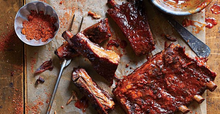 BABY BACK RIBS (Nancys)  3 cups water 1 bottle beer Juice and rind of 1 lime Dash Worcester sauce  Take membrane off ribs and cut into sections of 2 ribs each. Put liquid in crockpot and ribs on top and cook on high 4 hrs. Line cookie sheet with foil. Season ribs on both sides with a rub. Pour barbecue sauce down center of cookie sheet. Lay ribs on top and pour more sauce over ribs. Bake at 250 for 2 hours. After 1 hour pour more sauce on top if desired.