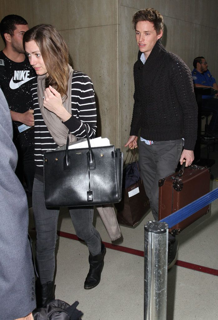 Newlyweds Eddie Redmayne and Hannah Bagshawe arrived at LAX on Wednesday.
