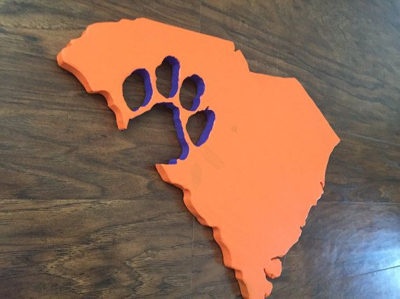Purchase a South Carolina sign with a Clemson Tiger Paw cut out. Please feel free to request a state sign cut out with your favorite team! We value your ideas for custom work and strongly encourage you to contact us with any request you may have. This item would make a great gift for any sports fan or college graduate! •Color options- orange, purple or white •Stain options- rustic red mahogany, drift wood or natural unfinished • requests for custom stain or colors are excepted •Demensions…