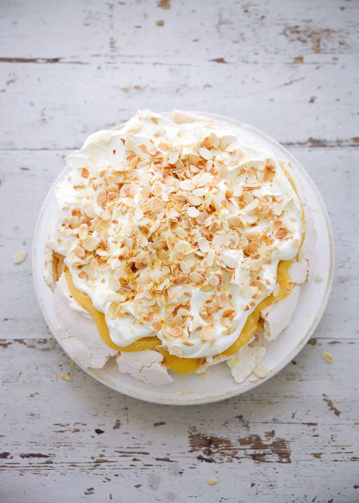 Lemon Pavlova. Making this today for my son's 1st birthday (minus the nuts). For the lemon curd, I used Nigel Slater's lemon curd recipe (I've pinned in my condiments section). So delicious!
