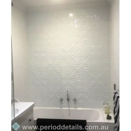 Large Maple Pressed Tin Panels in a Pearl White powdercoat create a stunning backdrop in this bathroom.