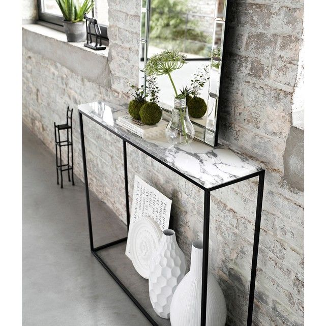 Mahaut console table. Marble is back... with these small yet playful touches. You'll easily find room in your home for this decorative and functional slimline console table. Features:- Black metal frame with matt black epoxy finish- Marble top. Each piece is unique so the marbled effect may vary. Size: - L90 x H75 x D22cmSize and weight of parcel: - L100 x H23 x D75.5cm, 21kgHome delivery:Your console table will be delivered to your door by appointment!Note! Please check that all access p...