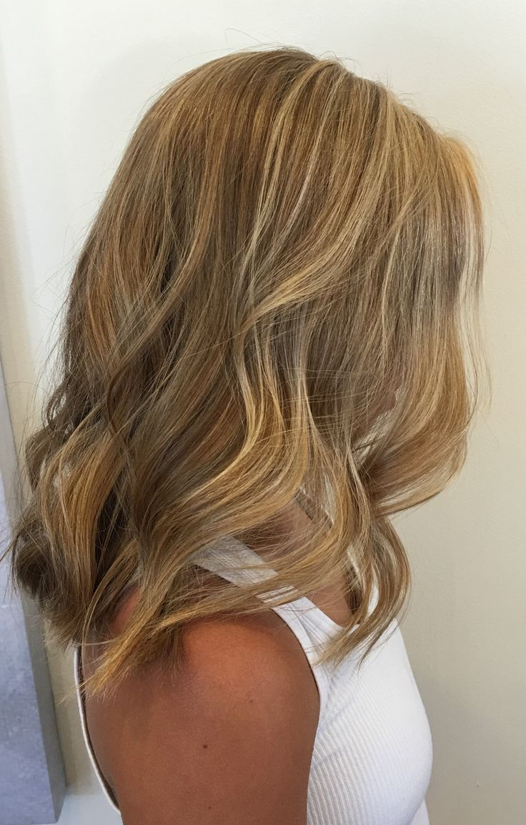 Aveda Hue Salon. Partial highlight with bleach, base break. 10N for 3 minutes.