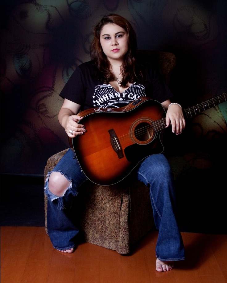 This is a cool photograph of the same high school senior. She's wearing the same Johnny Cash shirt and holding her guitar. She must have been a big fan of his music. http://www.senior-portraits.com