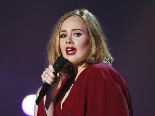 NEW YORK (AP) — Though dozens are nominated at Sunday's Grammy Awards, we all know the real showdown is between Beyonce and Adele. Both are